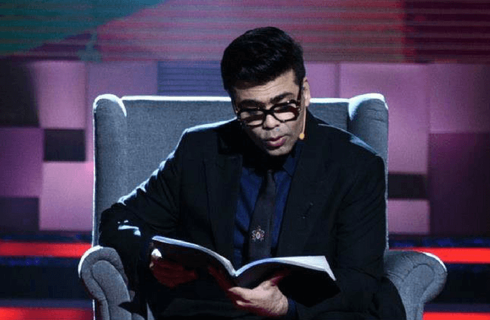 karan-johar-reading-source-peepingmoon